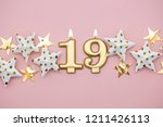 number 19 gold candle and stars ... | Shutterstock . vector #1211426113