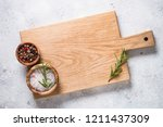 wooden cutting board with sea... | Shutterstock . vector #1211437309