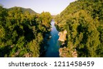 chilean andes river. chilean... | Shutterstock . vector #1211458459