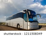 bus staying in the parking lot... | Shutterstock . vector #1211508349