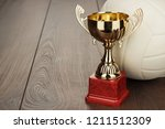volleyball and golden trophy... | Shutterstock . vector #1211512309