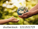 close up of senior hands giving ... | Shutterstock . vector #1211521729