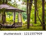Wooden Gazebo On Summer Forest...