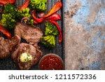 grilled beef steak with garlic... | Shutterstock . vector #1211572336