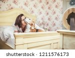 woman meet morning in bed with... | Shutterstock . vector #1211576173