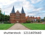 historical holstentor city gate.... | Shutterstock . vector #1211605660