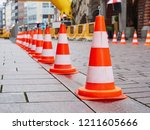 fencing for marathon in city... | Shutterstock . vector #1211605666