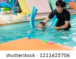 cute little asian 2 year old... | Shutterstock . vector #1211625706