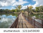 floating walkway over a lake... | Shutterstock . vector #1211653030