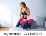 young woman packing sports... | Shutterstock . vector #1211657149