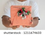 hand hold a give box | Shutterstock . vector #1211674633