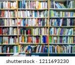 blurred of bookshelves in the...   Shutterstock . vector #1211693230