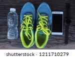 running shoes  phones  wrist... | Shutterstock . vector #1211710279