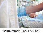 patient in serious condition... | Shutterstock . vector #1211728123