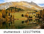 autumn scene at the palpuogna...   Shutterstock . vector #1211776906