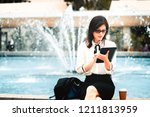 business woman using electronic ... | Shutterstock . vector #1211813959