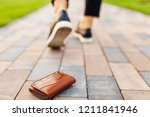 the girl lost a leather wallet... | Shutterstock . vector #1211841946