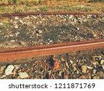 rusty abandoned rails. terrible ...   Shutterstock . vector #1211871769