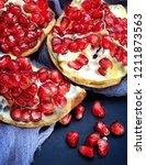 several pomegranates peeled | Shutterstock . vector #1211873563