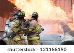 three firemen extinguishing a... | Shutterstock . vector #121188190