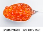 red caviar on silver spoon... | Shutterstock . vector #1211899450