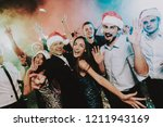 people in santa claus cap... | Shutterstock . vector #1211943169