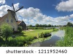 de rat windmill in ijlst... | Shutterstock . vector #1211952460