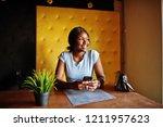 african american girl sitting...   Shutterstock . vector #1211957623