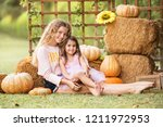 two young girls sitting on... | Shutterstock . vector #1211972953