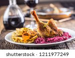 portion of roast duck leg red...   Shutterstock . vector #1211977249