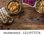 roasted duck legs in pan with... | Shutterstock . vector #1211977276