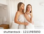 beautiful mother and teenager... | Shutterstock . vector #1211985850