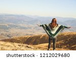 a girl in an authentic poncho... | Shutterstock . vector #1212029680