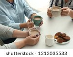 women drinking coffee at table | Shutterstock . vector #1212035533