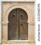 aged door in andalusian style... | Shutterstock . vector #1212048190