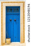 aged blue door in andalusian... | Shutterstock . vector #1212048196