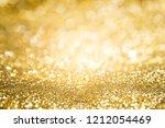 abstract background gold light... | Shutterstock . vector #1212054469