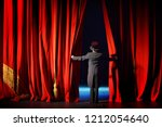 the actor in a tuxedo theatre... | Shutterstock . vector #1212054640