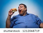happy obese man opening his... | Shutterstock . vector #1212068719