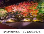 Stock photo light up at night autumn scenery of maple trees by majestic traditional japanese architectures in 1212083476