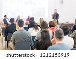 female speaker giving... | Shutterstock . vector #1212153919