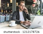 handsome young freelancer with... | Shutterstock . vector #1212178726