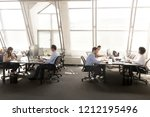 diverse employees group focused ... | Shutterstock . vector #1212195496