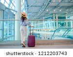 young woman in hat with baggage ... | Shutterstock . vector #1212203743