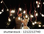 the night wedding ceremony.... | Shutterstock . vector #1212212740