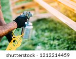 industrial male worker painting ... | Shutterstock . vector #1212214459