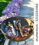 brazier with a fire  logs and... | Shutterstock . vector #1212231466