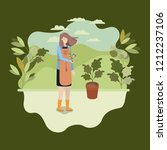 woman planting tree in the park | Shutterstock .eps vector #1212237106