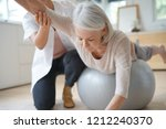 senior woman exercising with... | Shutterstock . vector #1212240370