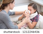 caring mother cures a young... | Shutterstock . vector #1212246436